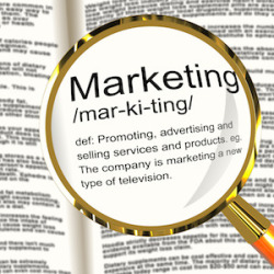 Marketing Definition Magnifier Showing Promotion Sales And Advertising